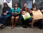 Women riding the MRT.